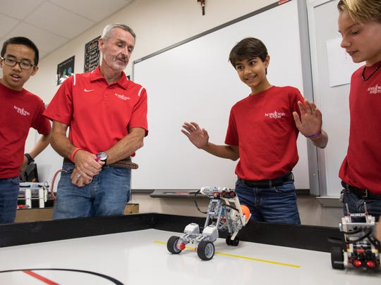 Nikolai Steen puts his hands in the as he test his robot in Robert Ludlow's robotics class at Incarnate Word Academy Middle School on Wednesday, Sept. 27, 2017.
