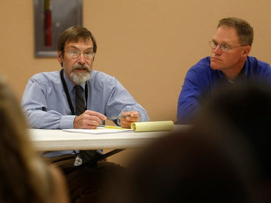 From left, Bloomfield City Manager Eric Strahl and Bloomfield City Engineer Jason Thomas participate in a meeting on Monday at the Bloomfield Multicultural Center that updated residents on repairs to the Bloomfield Irrigation Ditch.