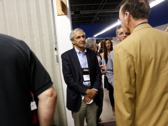 At center, Ken McQueen talks with New Mexico Tech Associate