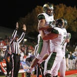 CSU tackle Sam Carlson lifts running back Izzy Matthews up to celebrate a touchdown during the Rams' Nov. 21 win at New Mexico. Carlson, a former Poudre High School standout, has accepted an invitation to play in the NFL Players Association Collegiate Bowl.