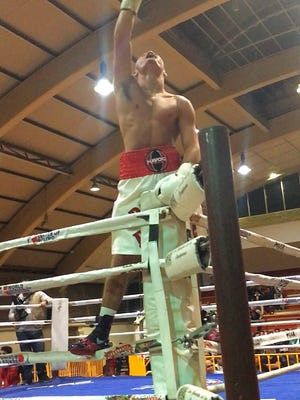 Ontario High School senior Chaise Nelson climbs the ropes to celebrate his knockout in his pro boxing debut in Mexico.