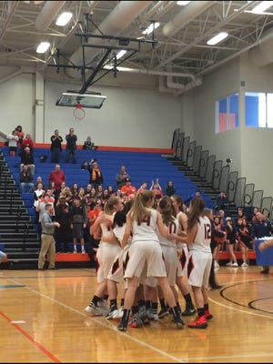 The Marlboro High School girls basketball team celebrates after winning the Section 9 Class B title on Sunday at SUNY New Paltz.