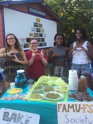 Adrianna Taylor, Savannah Shewan, Sidney Cameron and Jasmine Gay (pictured from left to right) table at First Friday for a SWE fundraiser.