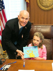 Gov. Rick Scott promised RayAnn Moseley Charlotte's Web would come to Florida.