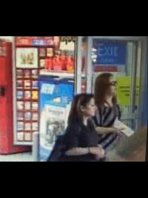 Two women were photographed at a Walmart on Aug. 9 using credit cards stolen from a vehicle earlier that day