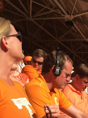 Jeremy Durham, center, sits between Sen. Brian Kelsey and his wife during Saturday's University of Tennessee football game.