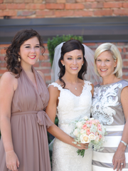 Nita Grizzard, right, with her daughters Abbie, left,