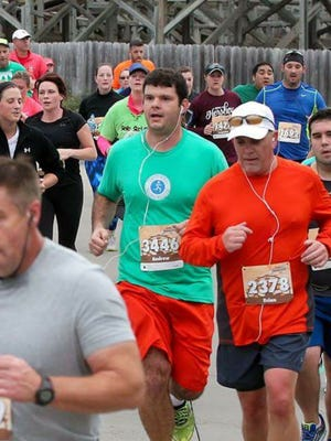 Andy Sandrick (center) completed the Hershey Half Marathon, crossing another running achievement off his list.