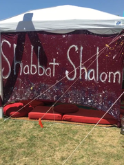 The Shabbat Shalom tent on the campgrounds of the Coachella Valley Music and Arts Festival encompasses five campsites. It's creators want Jewish festival-goers to know they can have a Shabbat meal while still enjoying the festival.