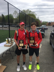 Zach Levin (right) and Brendan Holleran posing with trophies after winning doubles title.