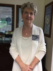 Patt Kakstis poses for a photo wearing her name tag,