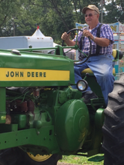 Violet Township Trustee and Fairfield County Antique Tractor Club Terry Dunlop parks a tractor in preparation for the Baltimore Festival. The festival will feature about 25 antique tractors on display.