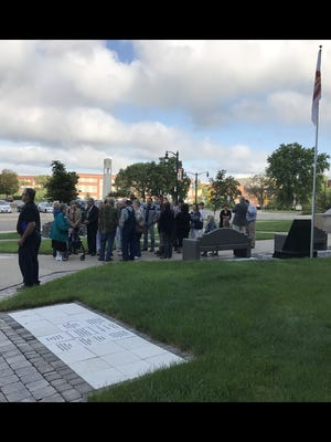 Those in opposition of Enbridge Energy's pipeline gather outside of the Wood County Courthouse in Wisconsin Rapids on Aug. 15. The board discussed a resolution that would support the reform of eminent domain laws in Wisconsin to protect the rights of private property owners whose land could potentially be used to build a new pipeline.