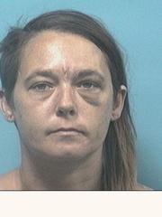 A mugshot of April Carpri after she was beaten near