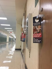 Door hangers about opioid abuse placed on the classroom doors at Ridge High School for Back to School Night.