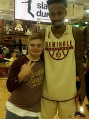 Arik Ancelin, left, meets FSU Seminoles point guard Braian Angola-Rodas, right, during Arik's recent visit to Florida State.