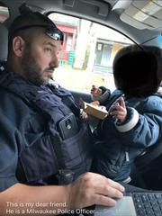 A screenshot of Facebook shows a photo of Officer Vin