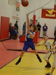 Gunner, playing his favorite sport, makes a jump shot