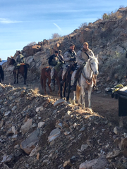 (R-L) Geoff Stults, Chris Hemsworth and Michael Pena on horseback on the New Mexico set of '12 Strong.'