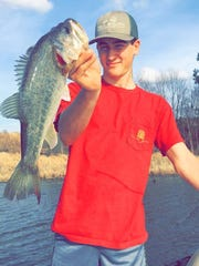Garrett Jackson, 17, hauled in this nice bass while fishing with Ivy Thurston, 15, in a private pond near Purvis.