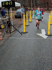 Shippensburg's Katie Larsen, wearing a look of determination, crosses the finish line at last weekend's Squirrelly Tail Twail Wun, a half marathon race at Gifford Pinchot State Park.