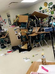 In this April 20, 2018, photo by Jake Mailhiot, desks,