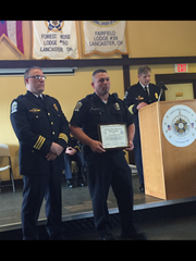 Police Officer John Browning (center) received the police department's 2017 Officer of the Year award Friday. Deputy Chief Dan Shupp is on the left and Chief Adam Pillar is at the podium.