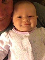 Christopher Cowles and his 15-month-old granddaughter Isabel.