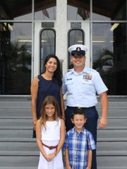 Snr. Chief Marco Cowley with is wife, Eliza, daughter, Julianne, and son, Adrian