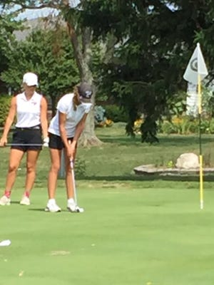 Ashland High's Klaira Paramore coverts a birdie on hole No. 9 at Seneca Hills on Friday during the Tiffin Columbian Invitational. Paramore earned medalist honors.