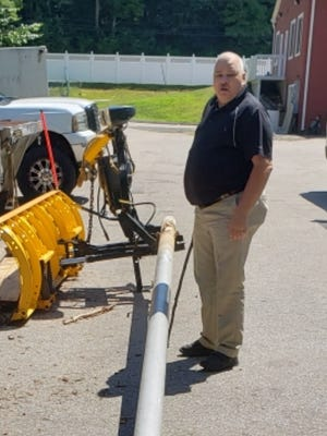 Norwich Area Veterans Council member Bob Murphy checks out a possible donated replacement for a missing flagpole originally slated to be placed at Samuel Huntington's tomb in Norwichtown.
