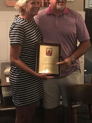 Bobbi Mock receives the Greg W. Oliver Memorial Coaching with Class Award from Dewey DeLettre, the president of the Savannah Basketball Officials Association, on Thursday night.