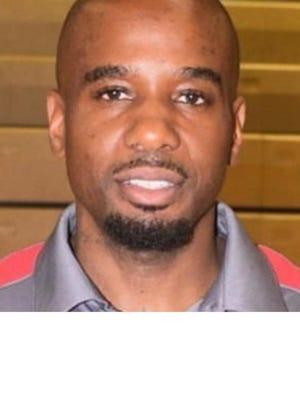 "Derrick ""Chuck"" Campbell got his first win as the boys basketball coach at Johnson."