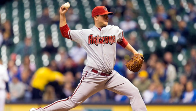 Arizona Diamondbacks pitcher Evan Marshall (50) throws a pitch during the seventh inning against the Milwaukee Brewers at Miller Park on May 6, 2014.