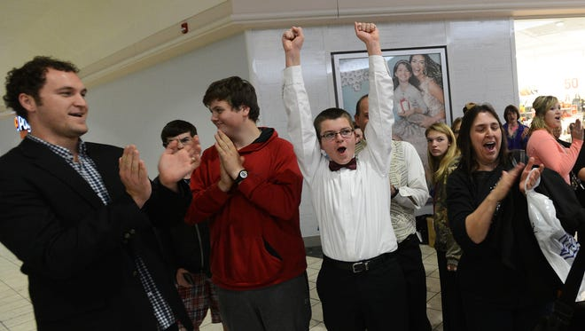 Faith Baptist School's Matthew Zockell celebrates as his choral group is named the winner of Monday night's Healthy Holiday Choral Competition at The Centre at Salisbury. Faith Baptist competed against Delmar High School.