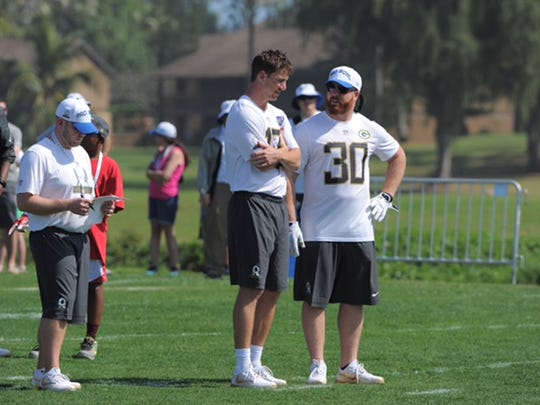 Green Bay Packers fullback John Kuhn, right, chats with New York Giants quarterback Eli Manning in Honolulu, Hawaii, ahead of Sunday's Pro Bowl. Kuhn, a Dover graduate, and Manning will take the field for the team coached by Pro Football Hall of Famer Jerry Rice.