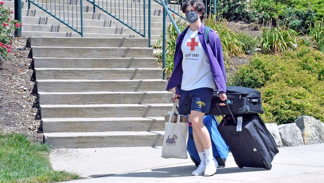 Otis Tucker, a College of Wooster student, makes his way to his dorm room Monday. Tucker is a sophomore from Portland, Oregon.