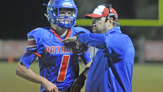 West End coach Kyle Davis talks to Eli Pearce before a play against Glencoe during a high school football game at Patriot Stadium in Walnut Grove on Nov. 1.