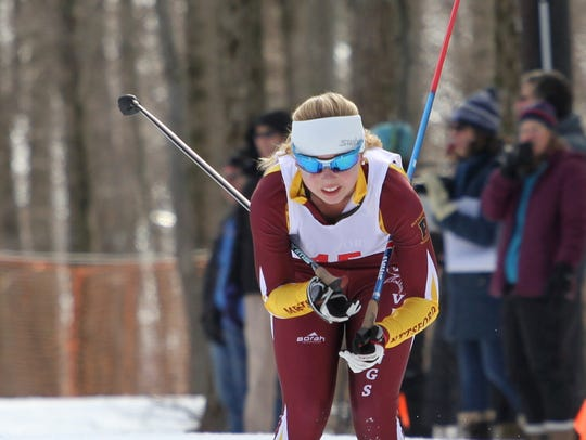 Pittsford Mendon's Sara Walter uses a pole given to