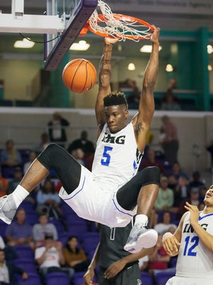 IMG Academy's Emmitt Williams scores against Norcross during play Saturday (12/17/16) at the Culligan City of Palms Classic at the Suncoast Credit Union Arena in Fort Myers. Williams scored 19 points in IMG's 62-95 victory.