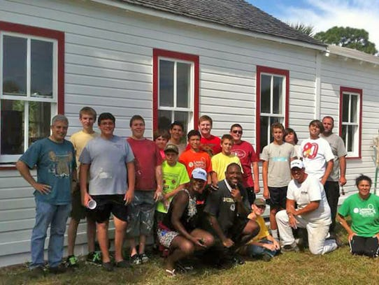 Linda Morgan and other volunteers refurbishing the