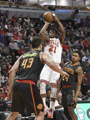 Chicago Bulls forward Jimmy Butler shoots the ball as Atlanta Hawks forward Kent Bazemore defends during the first quarter at the United Center.
