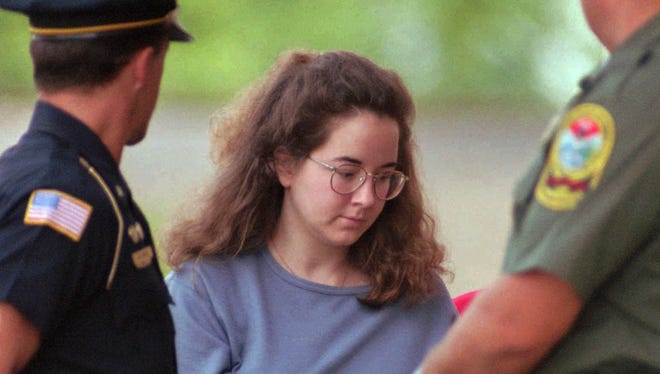 In this July 27, 1995 file photo, Susan Smith is escorted into the Union County Courthouse in Union, S.C.