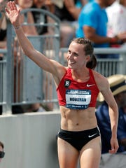 Shelby Houlihan waves to fans after winning the women's 1,500 meters at the U.S. Championships athletics meet Saturday, June 23, 2018, in Des Moines, Iowa.