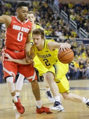 Michigan guard Spike Albrecht drives against Ohio State