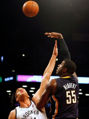 Brooklyn Nets center Brook Lopez (11) defends against Indiana Pacers center Roy Hibbert (55) in the second half at Barclays Center.