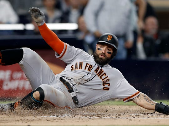 San Francisco Giants' Kevin Pillar slides in to home, scoring off a double by Austin Slater during the fifth inning of a baseball game against the San Diego Padres, Tuesday, July 2, 2019, in San Diego. (AP Photo/Gregory Bull)