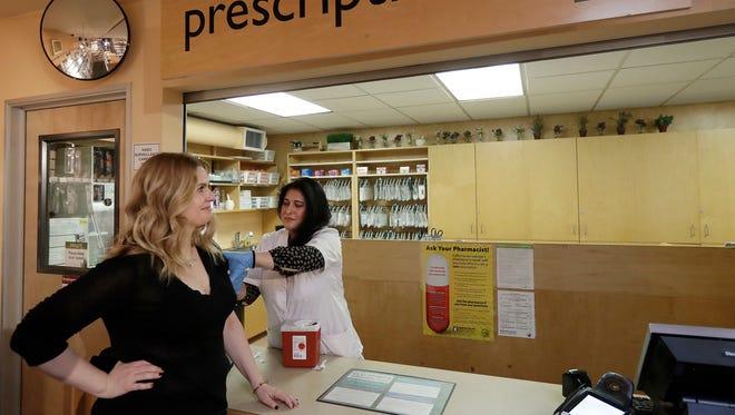 Pharmacist Smita Sane, right, gives a flu shot to Mariana Pabon at Pharmaca Integrative Pharmacy in San Francisco, California on Tuesday, Jan. 9.