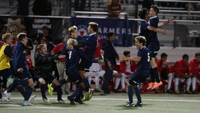 La Quinta players celebrate after winning CIF title