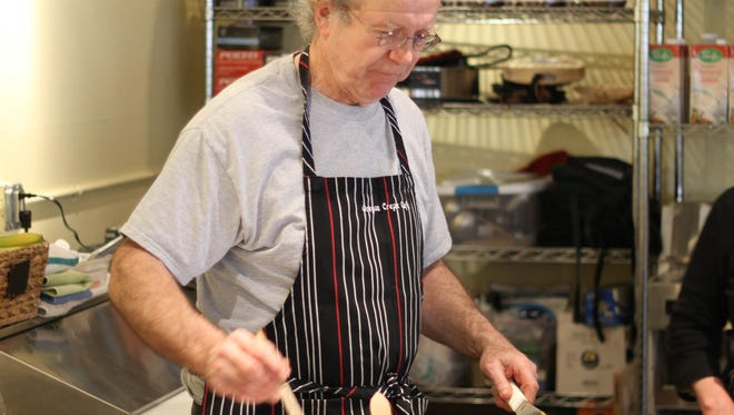 Oregon Crepe Cafe & Bakery owner Richard Foote prepares crepes for customers. Beginning April 10, Oregon Crepe Cafe & Bakery will be open 7 days a week.
